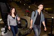 Ashley Greene and Joe Jonas are cute and happy as they arrive at LAX (Los Angeles International Airport). Upon arriving they are swarmed by tons of fans.