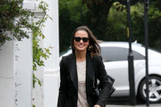 Birthday girl Pippa Middleton (b. September 6, 1983) is seen braving the rainy elements in London, wearing a white lace dress and sunglasses!.