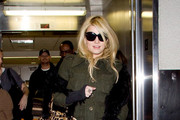 Jessica has a laugh as she arrives at LAX (Los Angeles International Airport).