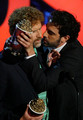 Actors Will Ferrell (L) and Sacha Baron Cohen accept their award for 'Best Kiss' onstage during the 2007 MTV Movie Awards held at the Gibson Amphitheatre on June 3, 2007 in Universal City, California.