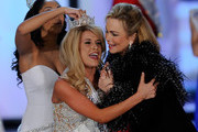 (L-R) Miss America 2010 Caressa Cameron crowns Teresa Scanlan, Miss Nebraska, the new Miss America as Miss America 1971 Phyllis George gives Scanlan a hug during the 2011 Miss America Pageant at the Planet Hollywood Resort & Casino January 15, 2011 in Las Vegas, Nevada.
