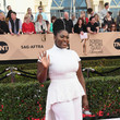 Danielle Brooks in White Pants and a Trained Top