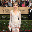 Julie Bowen in a Long Sleeve Sheer White Gown