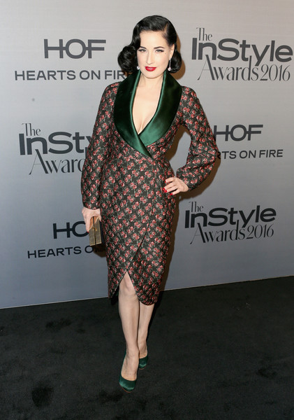 Dita Von Teese in an Emerald and Rose Coat Dress