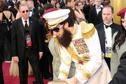Actor Sacha Baron Cohen, dressed as his character 'General Aladeen,' arrives at the 84th Annual Academy Awards held at the Hollywood & Highland Center on February 26, 2012 in Hollywood, California.
