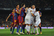 Cristiano Ronaldo (C) of Real Madrid argues with Barcelona players during the la liga match between Barcelona and Real Madrid at the Camp Nou stadium on November 29, 2010 in Barcelona, Spain.