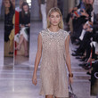 In A Whimsical Embellished Frock On The Runway