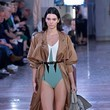Layering A Trench Over A One-Piece On The Runway