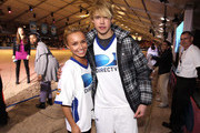 Actors Hayden Panettiere (L) and Chord Overstreet arrive at DIRECTV's Fifth Annual Celebrity Beach Bowl at Victory Park on February 5, 2011 in Dallas, Texas.