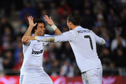 Cristiano Ronaldo of Real Madrid celebrates with Marcelo after scoring Real's third goal during the La Liga match between Getafe and Real Madrid at Coliseum Alfonso Perez stadium on January 3, 2011 in Getafe, Spain.