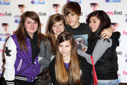 Justin Bieber poses as he signs copies of his new book First Step 2 Forever: My Story held at The Relentless Garage, Highbury Corner on December 5, 2010 in London, England.