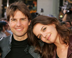 Actor Tom Cruise and actress Katie Holmes arrive at the Los Angeles fan screening of 'War of the Worlds' at the Grauman's Chinese Theatre on June 27, 2005 in Los Angeles, California.