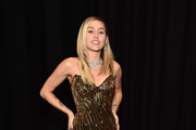 Miley Cyrus poses for a photo during NBC's