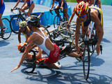 Lauren Groves of Canada, Ainhoa Murua of Spain and Ana Burgos of Spain crash during the cycling portion of the women's triathlon event at the Triathlon Venue on Day 10 of the Beijing 2008 Olympic Games on August 18, 2008 in Beijing, China.
