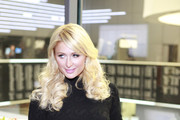 Paris Hilton poses at the Frankfurt Stock Exchange during her Rich Prosecco promotion tour on February 3, 2011 in Frankfurt am Main, Germany.