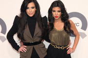 Kim Kardashian and Kourtney Kardashian attend the QVC 25 to watch party at 229 West 43rd Street on February 11, 2011 in New York City.