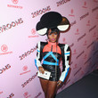 Wearing A Colorful Leather Romper And Black And White Headpiece At The Refinery29 29Rooms Opening Party In LA