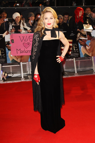 Wearing A Black Velvet Column Dress And Matching Lace Cape At A UK Premiere In 2012