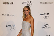 Model Heidi Klum attend amfAR MILANO 2011 at La Permanente on September 23, 2011 in Milan, Italy.