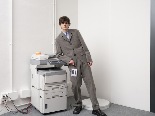 Andrea Pompilio at Milan Fall 2021 [shoulder,sleeve,standing,office supplies,output device,automotive design,blazer,suit,workwear,chair,furniture,andrea pompilio,product design,design,product,shoulder,desk,sleeve,standing,milan fashion week,furniture,desk,product design,design,product]