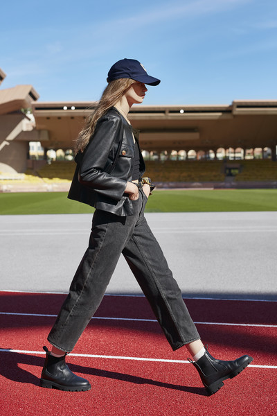 Céline at Paris Spring 2021 [standing,footwear,fashion,jacket,street fashion,leather,headgear,shoe,outerwear,leg,shoe,outerwear,jeans,celine,spring,standing,street fashion,leather,headgear,paris fashion week,celine,shoe,spring,jeans,summer,2021,denim m,2020,outerwear]