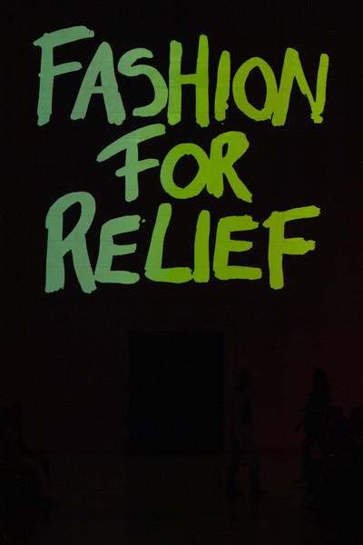 Fashion For Relief at London Spring 2020 [text,text,font,black,green,graphic design,graphics,logo,brand,darkness,illustration,computer,green,logo,fashion,relief,wallpaper,neon sign,meter,london fashion week,neon sign,logo,neon,wallpaper,green,m,computer,meter]