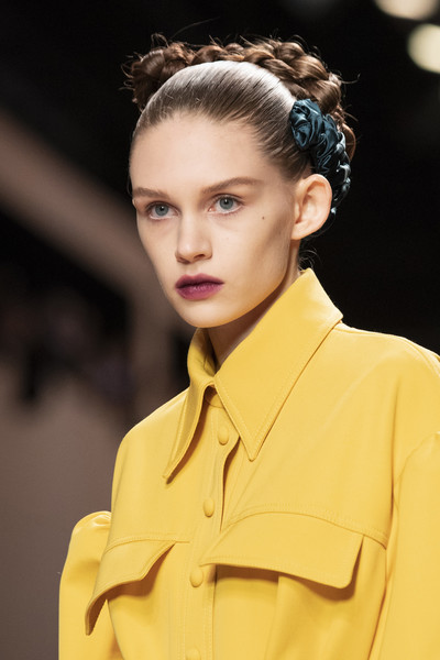 Fendi at Milan Fall 2020 (Details) [hair,fashion model,hairstyle,fashion,beauty,eyebrow,lip,chin,skin,yellow,fashion,beauty,fashion week,model,haute couture,runway,hairstyle,fendi,milan fashion week,fashion show,milan fashion week,haute couture,fashion,fashion week,fashion show,beauty,model,runway,paris fashion week]