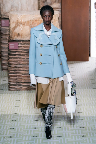 Lanvin at Paris Fall 2019 [clothing,street fashion,fashion,coat,outerwear,fashion design,trench coat,beige,footwear,overcoat,outerwear,fashion,fashion week,runway,fashion design,trench coat,paris,lanvin,paris fashion week,fashion show,paris fashion week,lanvin,fashion,runway,fashion show,ready-to-wear,autumn,paris,fashion week]