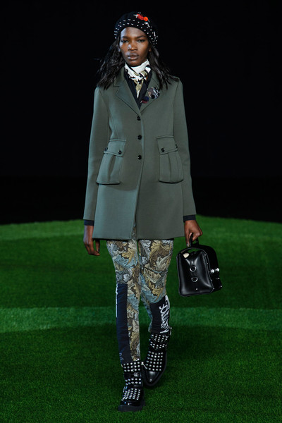 Marc by Marc Jacobs at New York Fall 2015 [runway,fashion,green,clothing,fashion show,fashion model,coat,fashion design,outerwear,footwear,trousers,marc by marc jacobs,runway,fashion,model,boot,fanny pack,leather,fashion model,new york fashion week,runway,fashion,model,marc jacobs,trousers,boot,fanny pack,beret,leather]