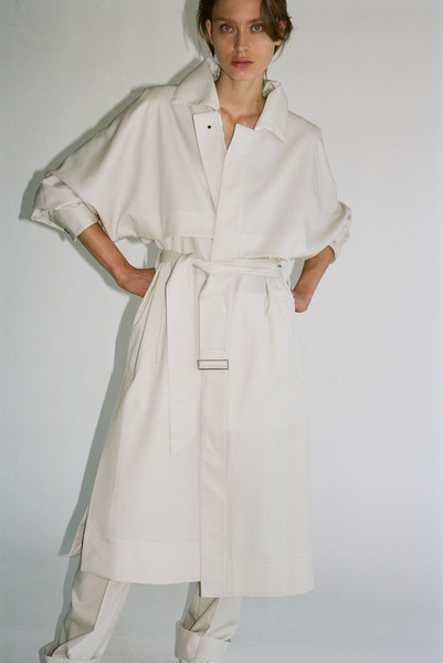 Overcoat at New York Spring 2022 [overcoat,sleeve,waist,dress,gesture,day dress,one-piece garment,knee,collar,street fashion,dress,trench coat,trousers,overcoat,fashion,coat,trade balance,costume,sleeve,new york fashion week,coat,overcoat,fashion,trench coat,robe,trade balance,trousers,dress,costume,double-breasted]