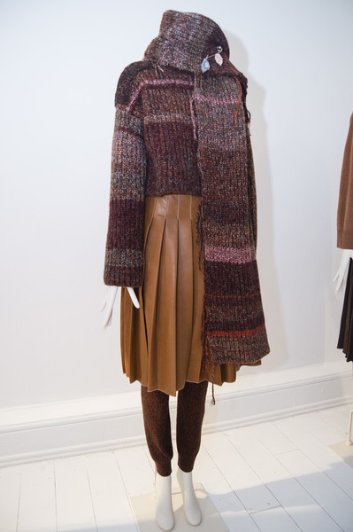 Pringle of Scotland at London Fall 2018 [clothing,outerwear,brown,fashion,wool,woolen,pattern,plaid,wrap,scarf,outerwear,brown,tartan,clothing,pattern,wrap,fashion,wool,pringle of scotland,london fashion week,tartan,outerwear]