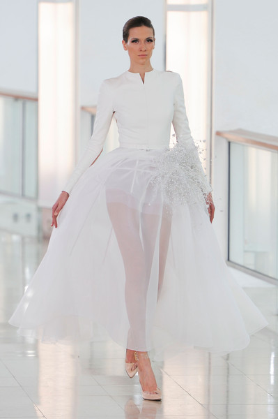 Stéphane Rolland at Couture Spring 2015 [couture spring 2015,fashion model,clothing,white,fashion,dress,haute couture,shoulder,gown,wedding dress,fashion show,stephane rolland,fashion designer,fashion,haute couture,fashion week,fashion design,spring,runway,fashion show,haute couture,fashion week,fashion,runway,spring,fashion show,fashion design,autumn,fashion designer,ready-to-wear]