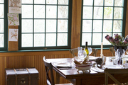 A porchlike dining room with a beadboard ceiling