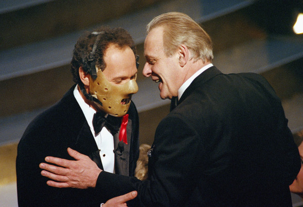 1991: Billy Crystal Wears Hannibal Lector Mask