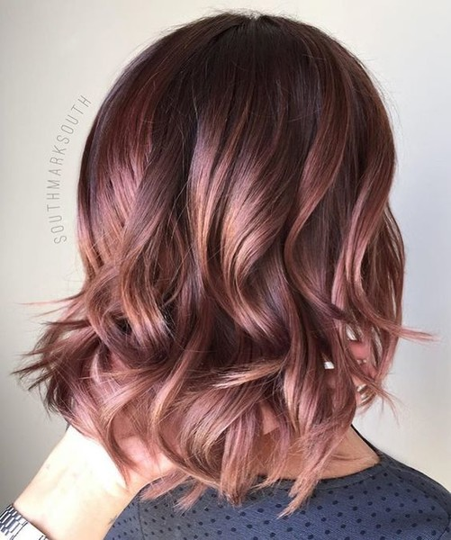 Bronzed Gold Curls - Rose Gold Hair Ideas That'll Have You