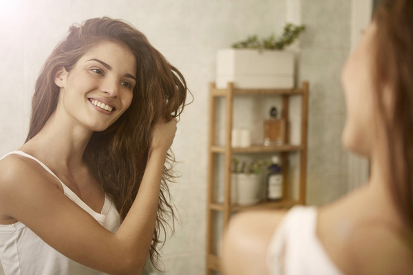 MYTH: Shampooing Less Reduces Oil