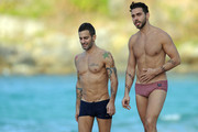 Famed designer Marc Jacobs walks the beach in St. Barts with his ex-fiance Lorenzo Martone. The couple each wore a pair of skimpy swimming shorts as they strolled the beach, Marc in navy blue and Lorenzo in a striped red pair.
