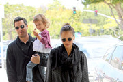 Jessica Alba tries to hide her baby bump under some loose fitting maternity wear while out for brunch with husband Cash Warren and daughter Honor. Alba, who is reportedly pregnant with a sister for Honor, dined at Harvest in Brentwood.