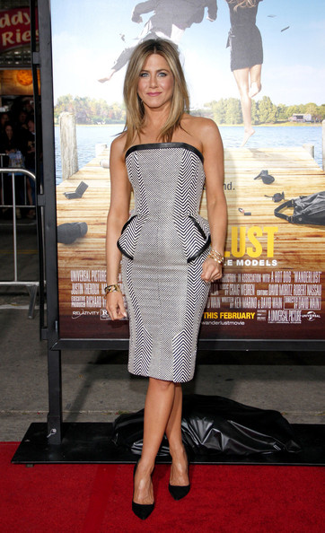 Wearing A Peplum Tom Ford Dress At The 'Wanderlust' Premiere