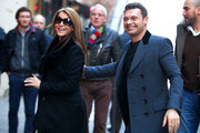 Ryan Seacrest and his girlfriend Julianne Hough spent Thanksgiving with his family in France .They smiled for the cameras all day today while they checked out a Monet exhibit at the Grand Palais, then while they met up with the rest of the Seacrest family to go shopping at Christian Louboutin. Ryan tweeted earlier in the week that he was